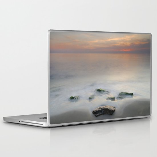 Calm red sunset at the beach Laptop & iPad Skin