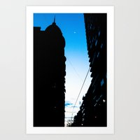 The Moon Between The Bui… Art Print