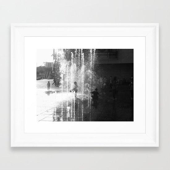 a child under water Framed Art Print