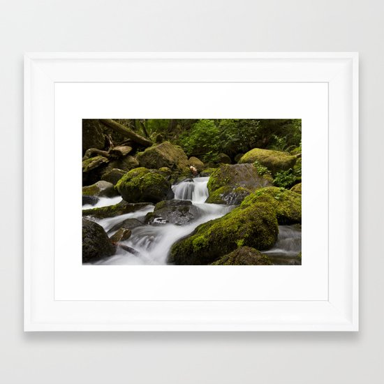 Water over moss Framed Art Print