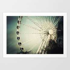 The Wheel Goes Round and Round Art Print