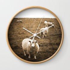Sheep in a field Wall Clock