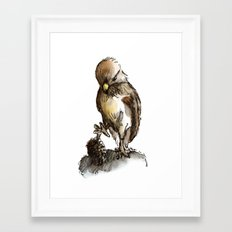 Little eagle playing with a pine cone Framed Art Print