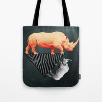 The Orange Rhinoceros Wh… Tote Bag