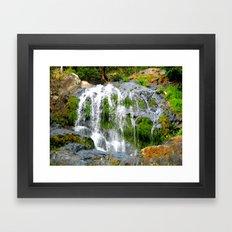 Waterfall over green rocks Framed Art Print