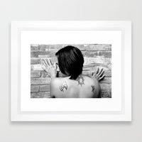 Tattooed girl against brick wall Framed Art Print