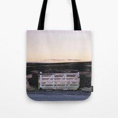 White gate leading to moorland at twilight. Derbyshire, UK. Tote Bag