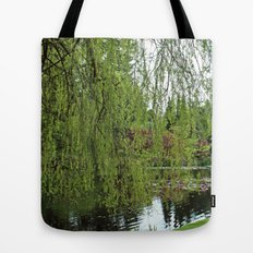 Lovely, soft green spring willow tree by the pond Tote Bag