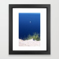 Lonely sailboat off the Mediterranean coast Framed Art Print