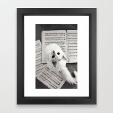 the cat and the music Framed Art Print