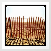 Fence in the sand. Art Print