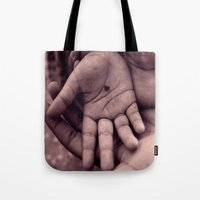 In my hand I hold... Tote Bag