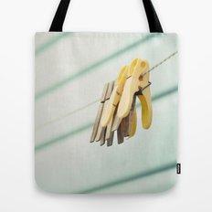 Pegs by a beach hut Tote Bag
