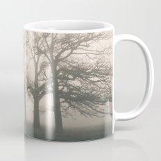 Early morning sun and trees in fog. Hilborough, Norfolk, UK. Mug