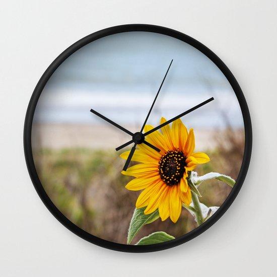 Sunflower near ocean Wall Clock