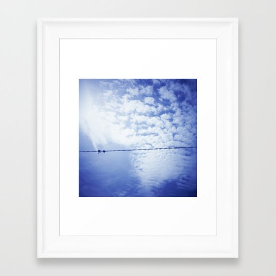 Birds on the wire. Framed Art Print