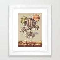 Framed Art Print featuring Flight Of The Elephants  by Terry Fan