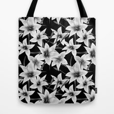 White lilies on a black background .  Tote Bag