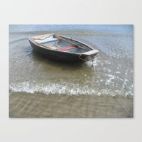 Wooden boat in the surf Canvas Print