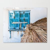 Distressed Blue Wooden Shutters and Beach Umbrella in Crete. Canvas Print