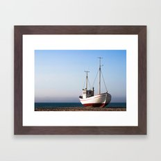 Fishing boat pulled up on beach Framed Art Print
