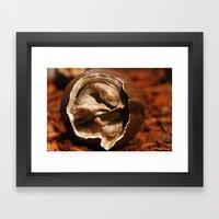 Dinosaur egg with embryo Framed Art Print