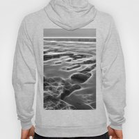 Abstract coastal rock formations in Queensland Hoody