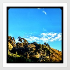 Trees and clouds in the sky. Art Print