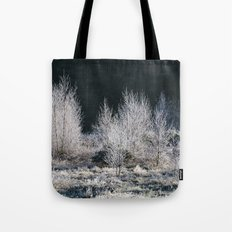 Young trees covered in a thick white frost. Norfolk, UK. Tote Bag