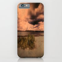 iPhone Cases featuring Menacing clouds over the sea by Tanja Riedel