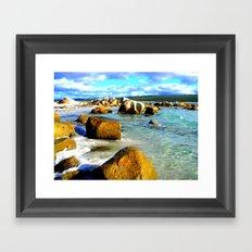 Rocks in the ocean on a sunny day Framed Art Print