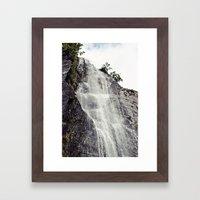 Waterfall Disperses Against the Rocks Framed Art Print
