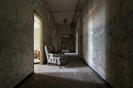Chair in asylum hallway Art Print
