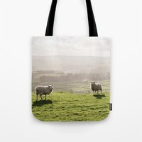 Sunlit sheep on a hilltop at sunset. Derbyshire, UK. Tote Bag