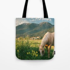 Pretty Horse Eating Grass in the Montana Sunset Tote Bag