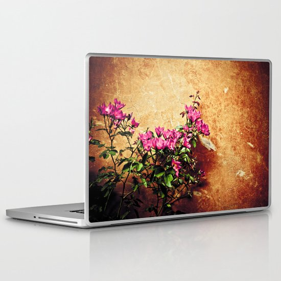 Pink flowers against weathered wall Laptop & iPad Skin