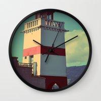 light on a shore Wall Clock