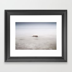 Lonely rock at the silver sea Framed Art Print