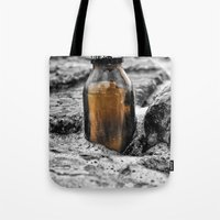 Message in a bottle Swept away by the sea Secrets held within Dreams of you and me Tote Bag