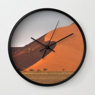 Wall Clock featuring The Red Sand Dunes Of So… by Light Wanderer