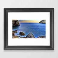 Beach At Sunset With A R… Framed Art Print