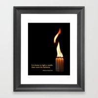 A Candle Against The Dar… Framed Art Print