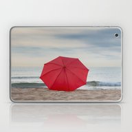 Red Umbrella Lying At Th… Laptop & iPad Skin