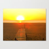 Pier and beach at sunset Canvas Print