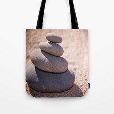 Balancing the world Tote Bag