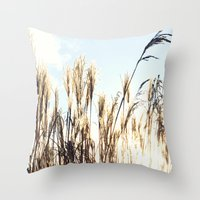 sun setting on reeds Throw Pillow