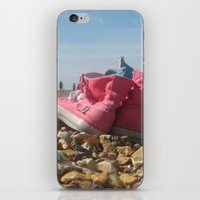 Pink shoes relaxing on the beach iPhone & iPod Skin
