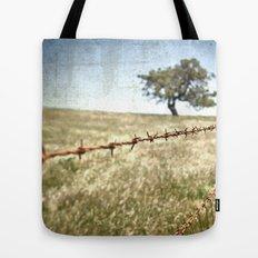 Tree Behind Fence Tote Bag