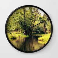 a tree by the river Wall Clock