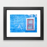Window with red frame on blue wall Framed Art Print